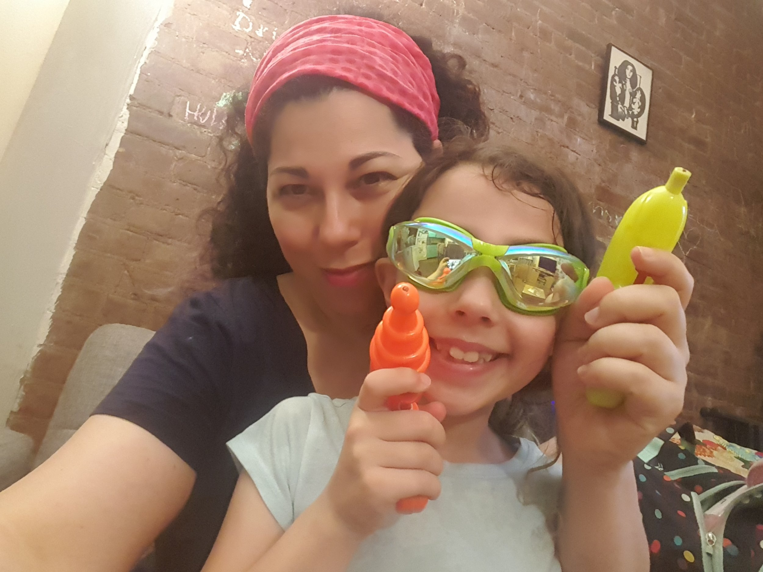 Mommy-daughter waterfight