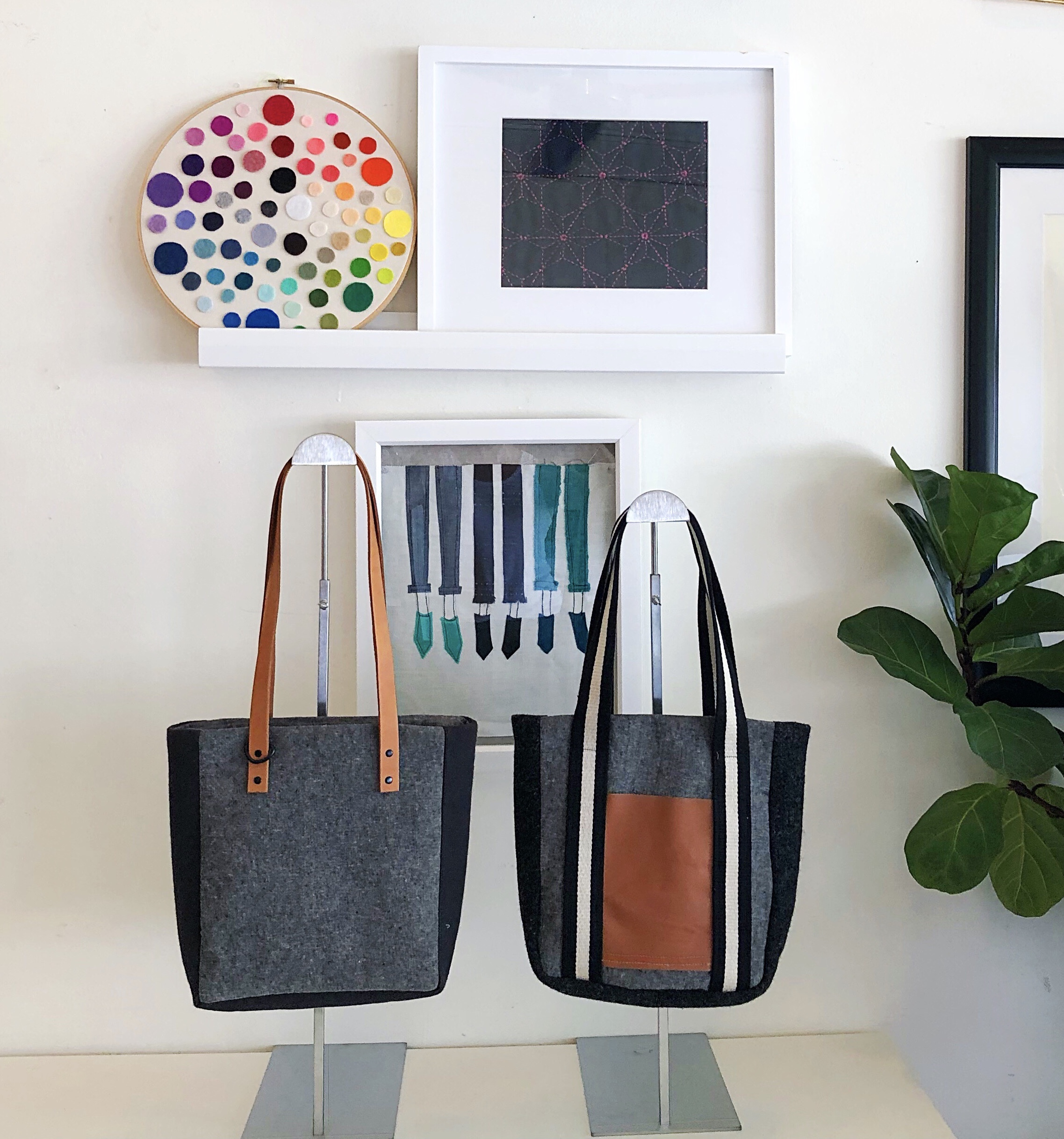 The Heidi Side Panel tote from my book,  Sew Bags: The Practical Guide to Making Purses, Totes, Clutches and More , in two ways. The first, with leather straps set with rivets and extra handy D-ring detail, the second with cotton webbing strap detail and leather front patch pocket.