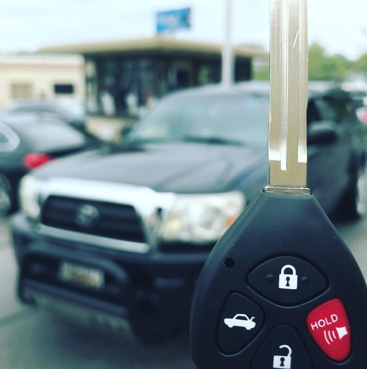 Car Locksmith at Sears The Keyless Shop cut and program Toyota Remote Key.