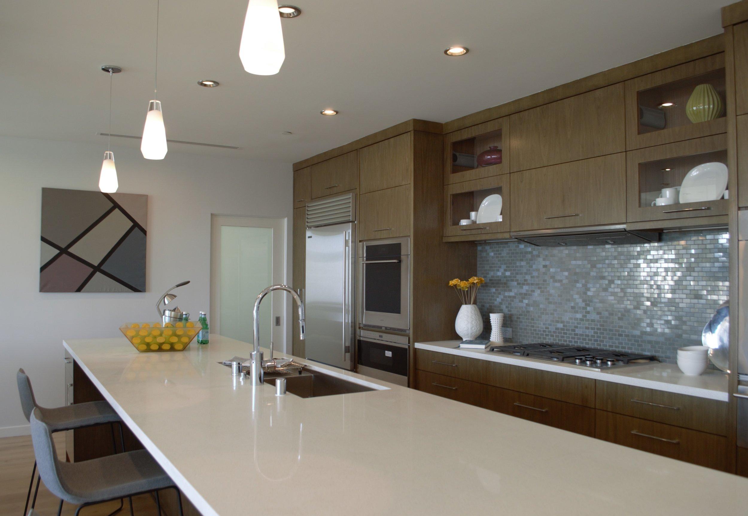 kitchen design, walnut cabinetry, quartz counters, artwork, waterstone faucet, interior design, modern, midcentury, daltile, stainless steel, y-lighting