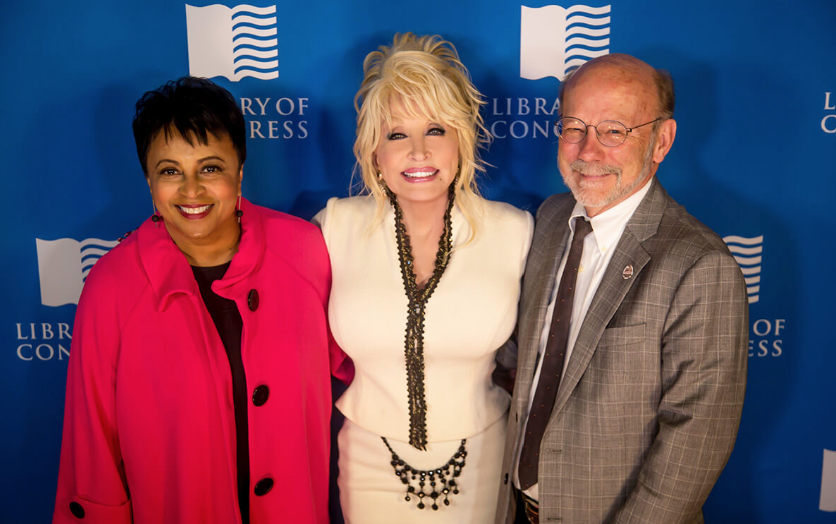Librarian of Congress, Carla Hayden; Dolly Parton; Dollywood Foundation Executive Director Dave Dobson dedicating the 100 Millionth Book at the Library of Congress in 2018. Credit: DollyParton.com
