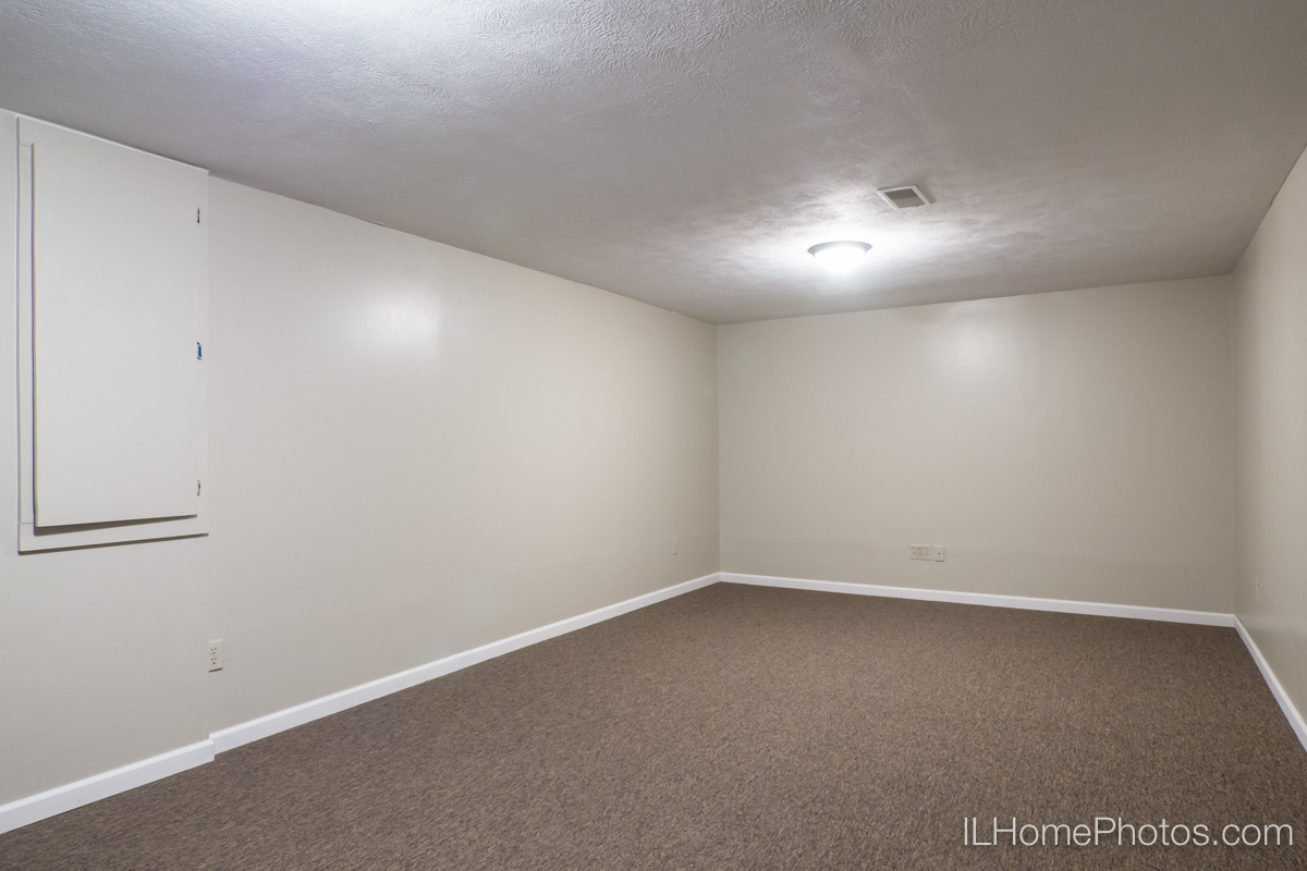 Interior basement family room photograph for real estate in Peoria, IL :: Illinois Home Photography by Michael Gowin, Lincoln, IL