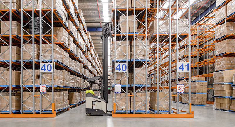Accessing double-deep storage locations in Colby double-deep racking