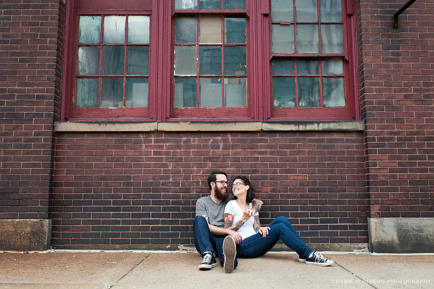 Carly + Phil rocked jeans, neutral t-shirts, and converse for their summer engagement session, allowing us to have a lot of fun in urban areas around Buffalo, NY for their summer engagement session.