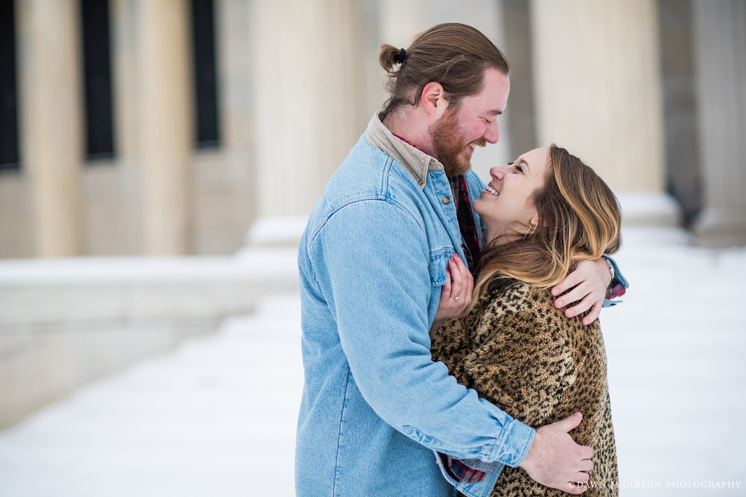 A warm leopard print coat paired with Zoe's dad's jean jacket on her man, Jon, added perfect personal touches all around to this wonderful winter engagement session.