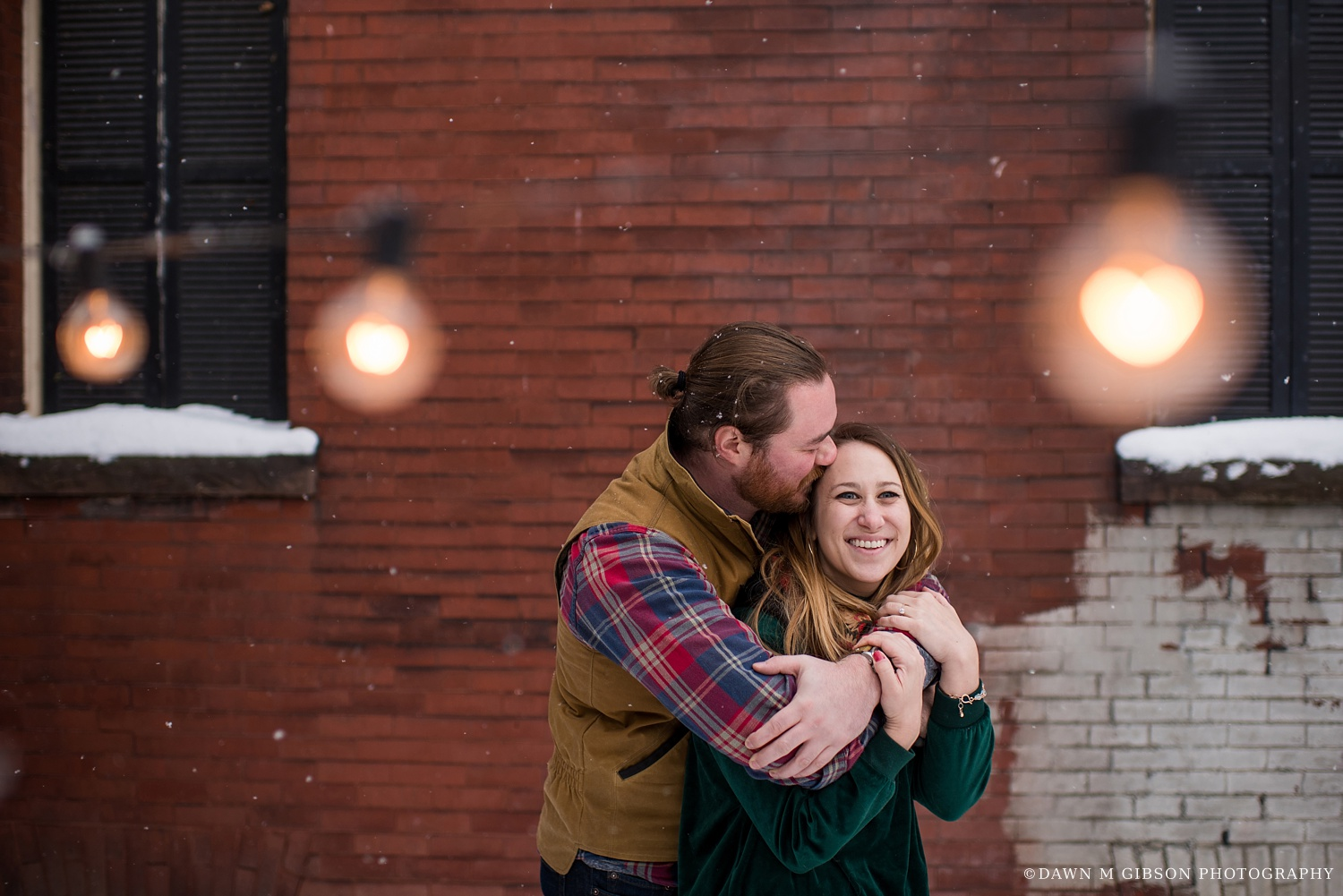 Zoe and Jon nailed their winter engagement session outfits here – right down to Zoe's red nailpolish to tie in with Jon's plaid shirt and the brick wall in their backyard. Still swooning over this one.