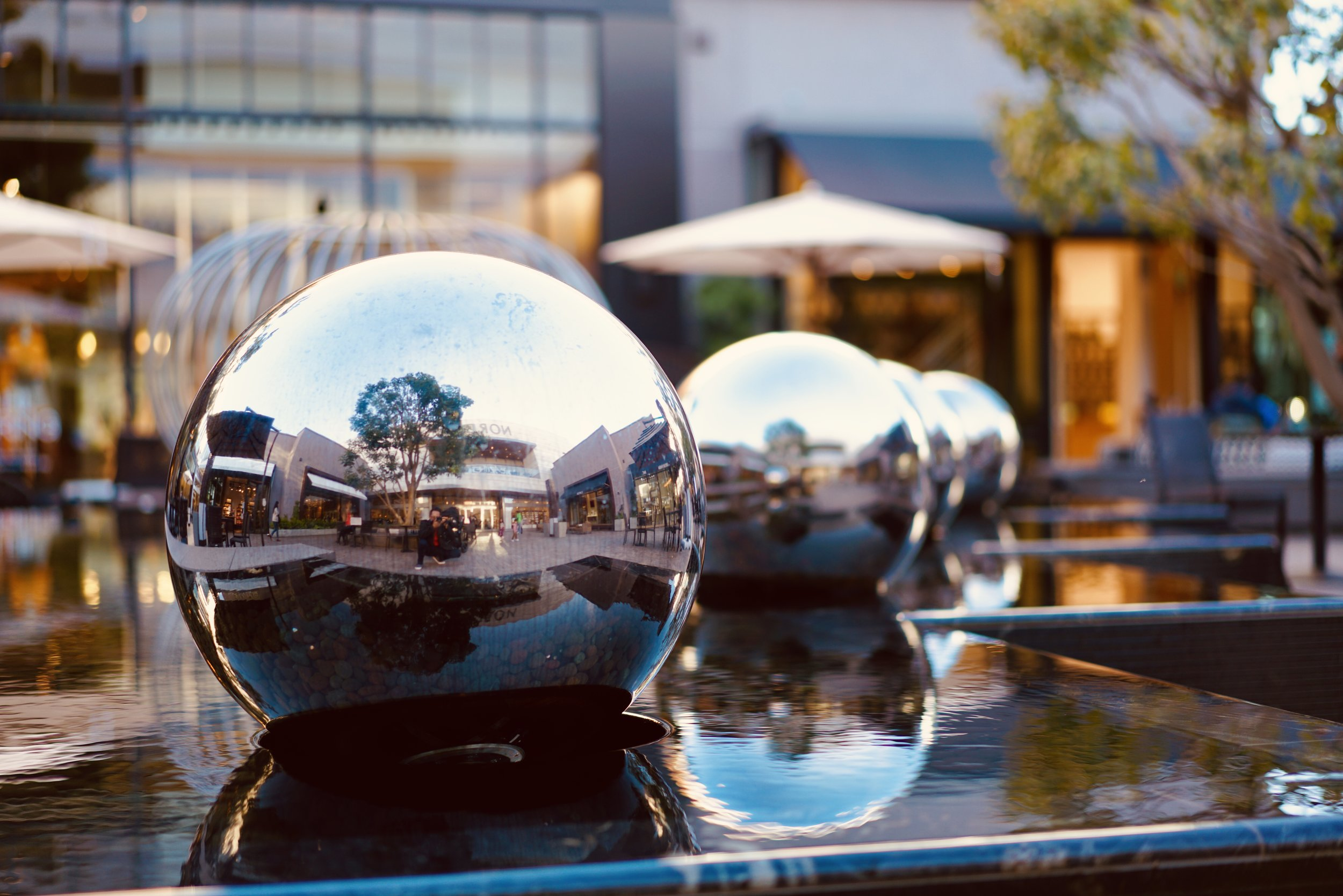The water fountain / reflection balls outside of Nordstrom. See if you can find the entire family.