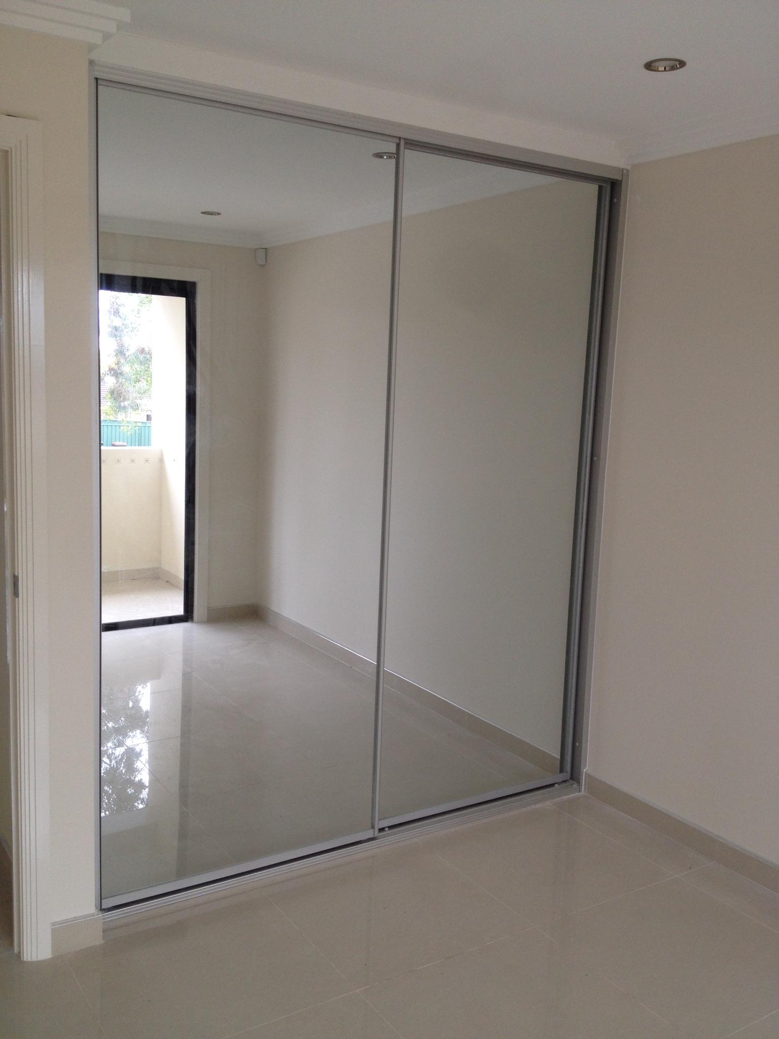 mirror sliding doors with matte silver frame.JPG