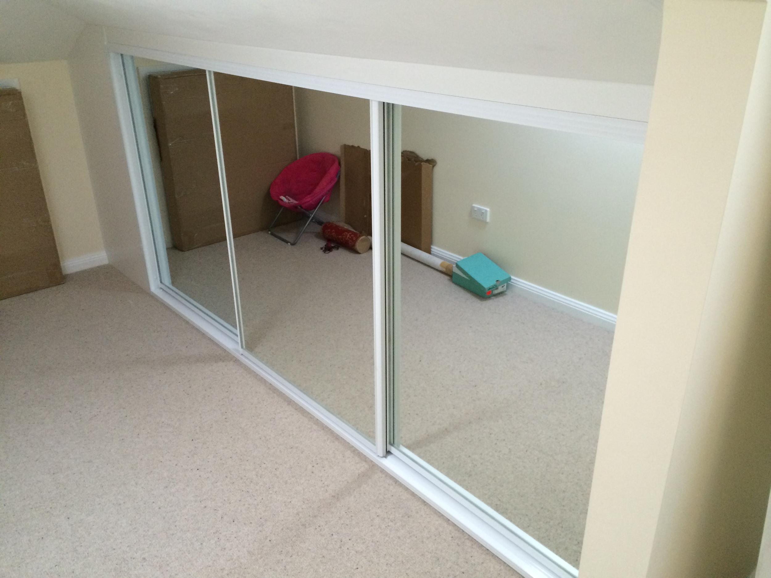 small wardrobe with mirror doors.JPG