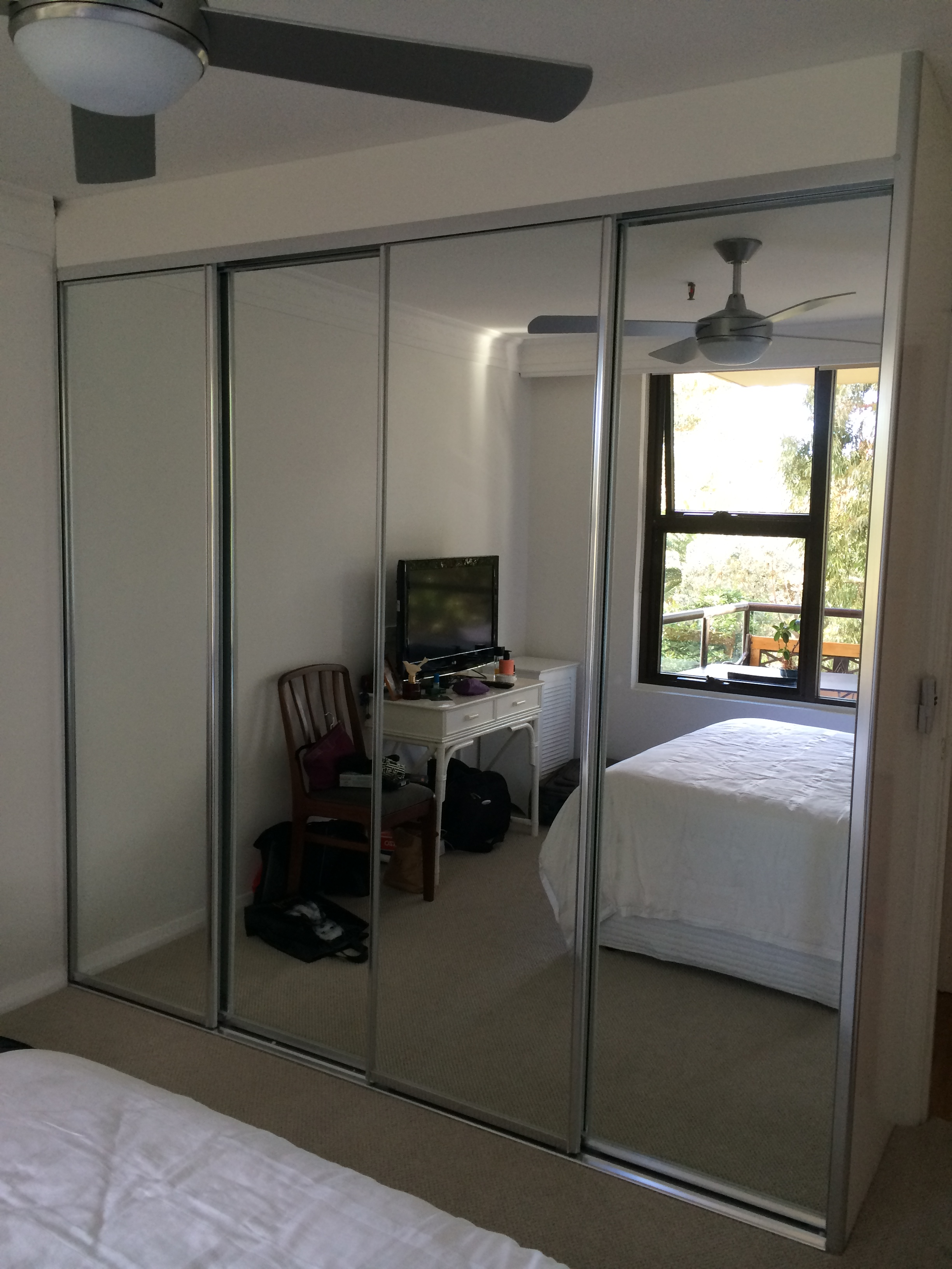 four door mirror wardrobe with polished silver frame.JPG