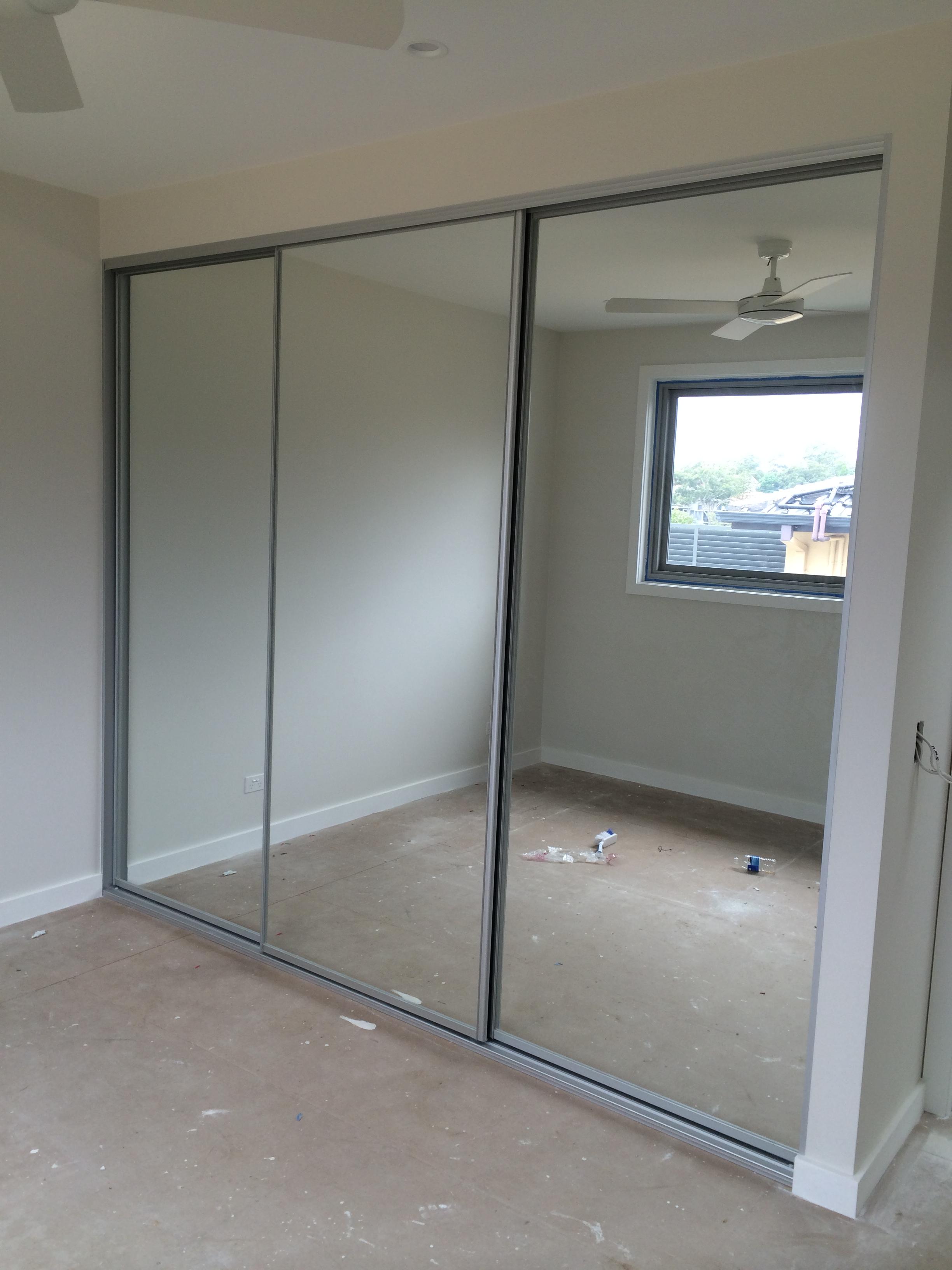 three door mirror wardrobe in existing gyprock frame.JPG