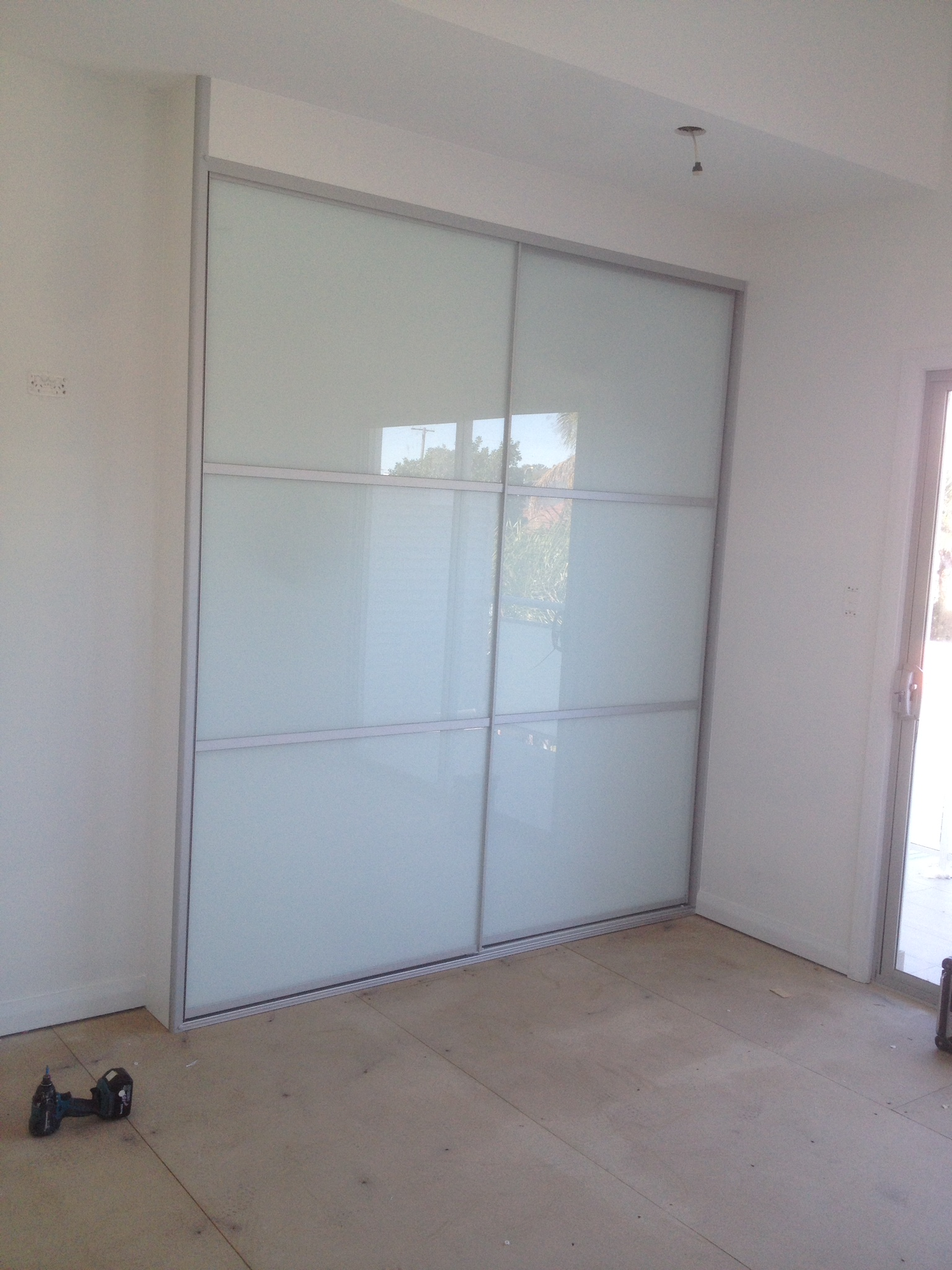 frosted glass doors with matte silver strips.JPG