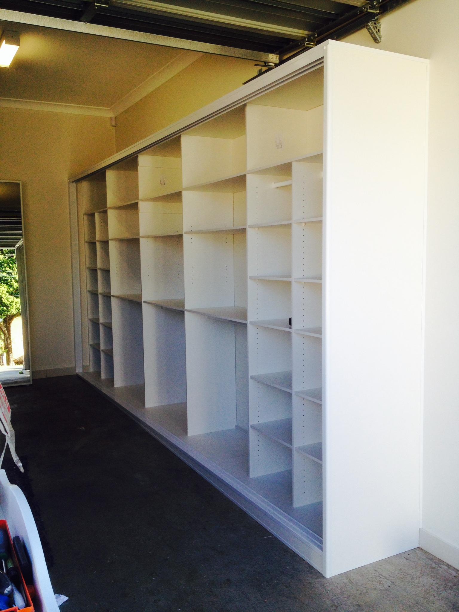 garage sliding wardrobe internal shelving.JPG