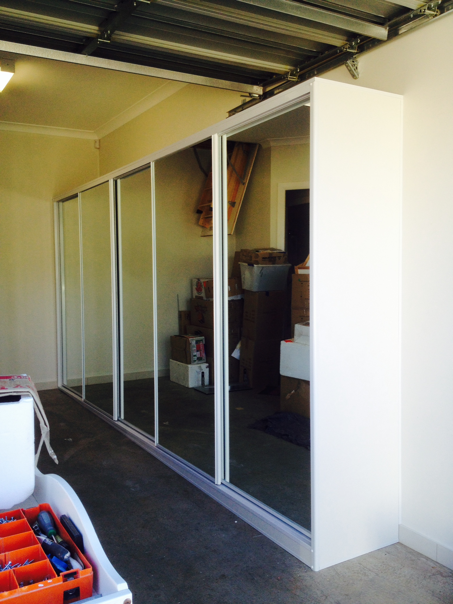 mirror sliding doors in garage.JPG