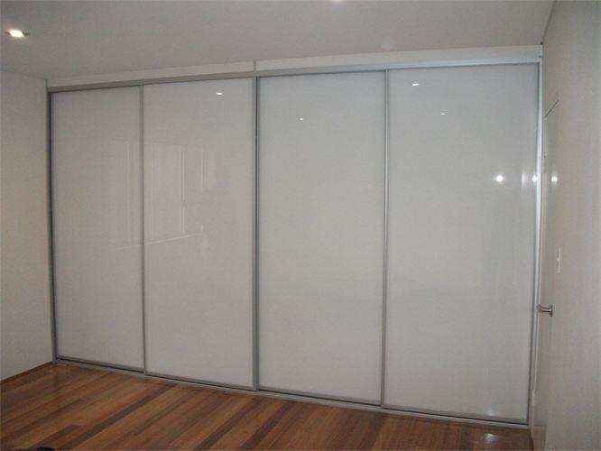 sliding ultra white glass doors with matte silver frame.JPG