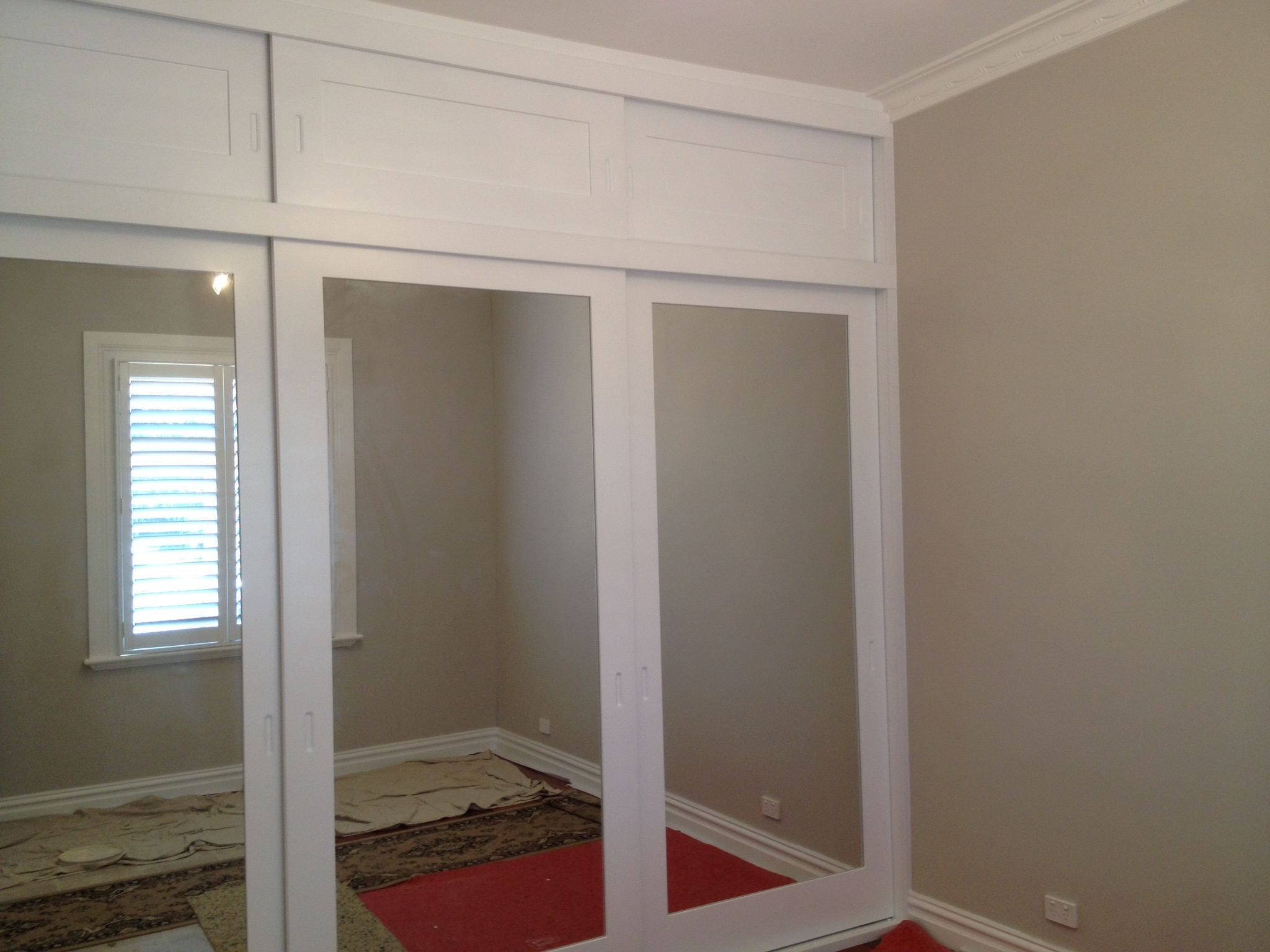 polyurethane sliding wardrobe with top doors.JPG