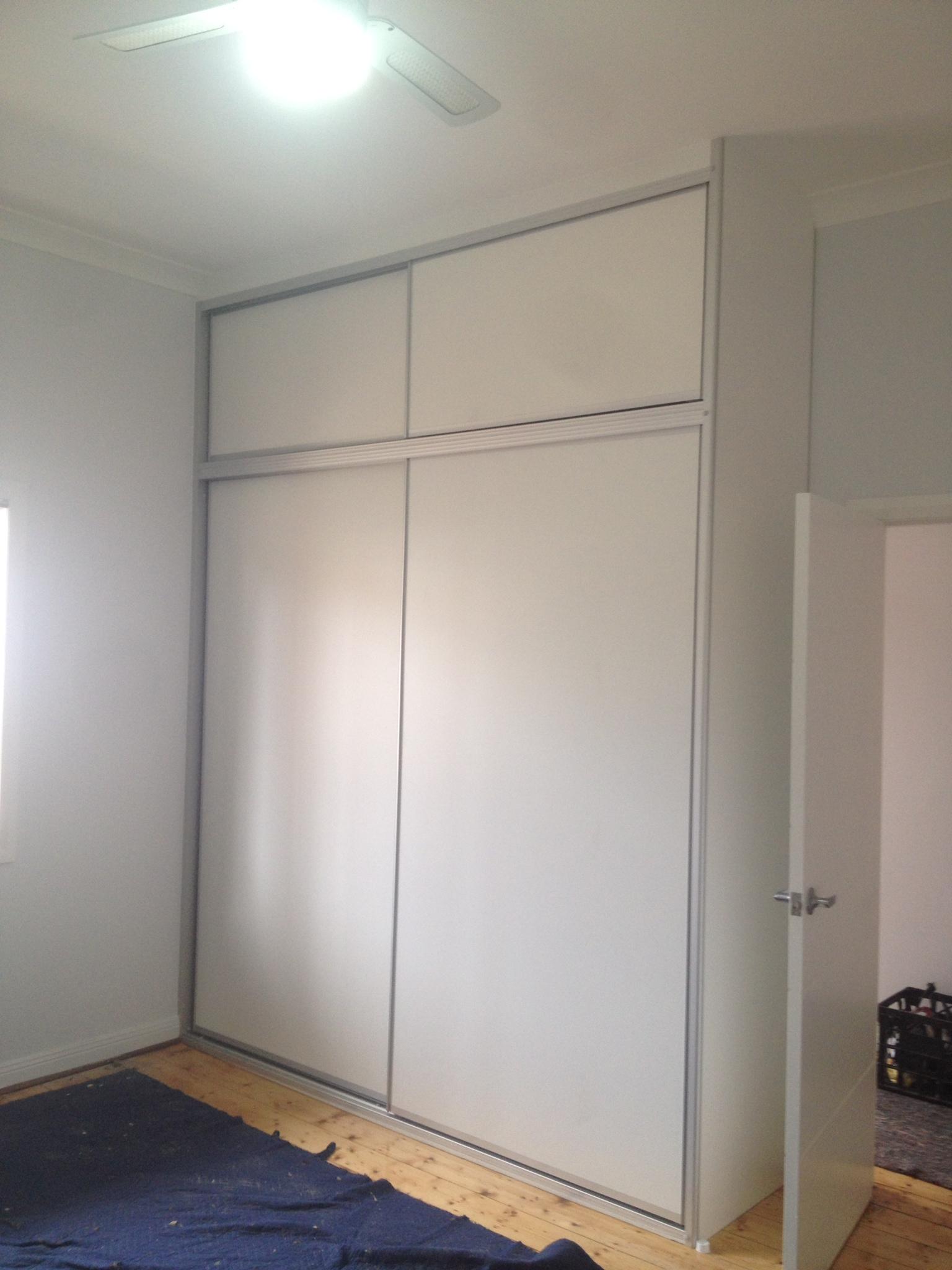 white melamine overhead doors with matte silver frame.JPG