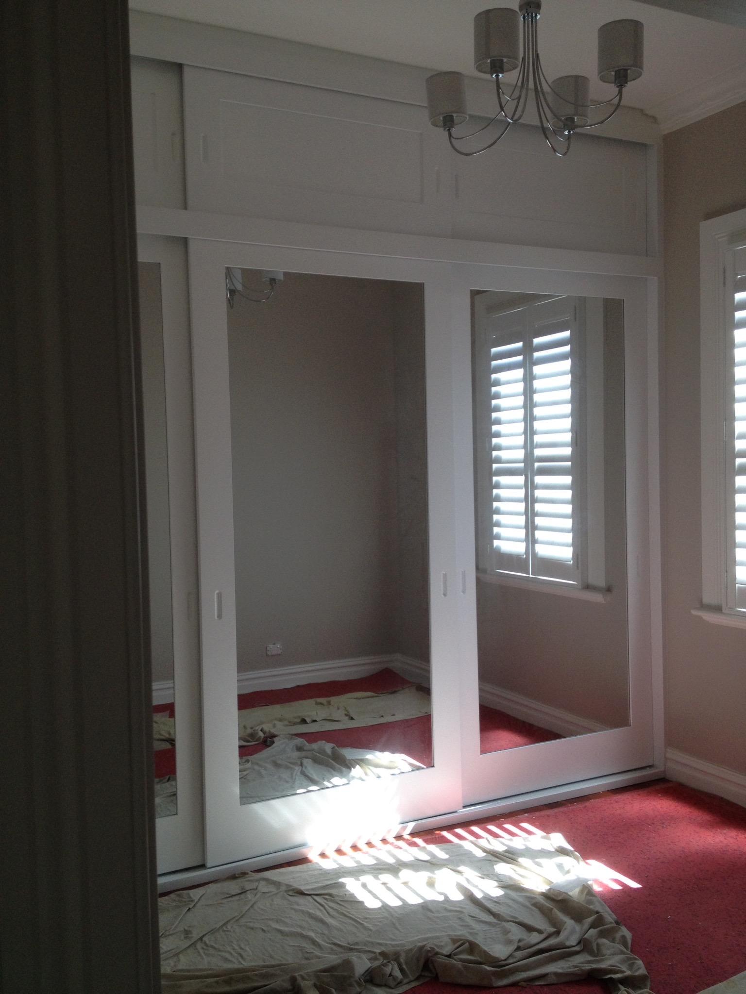 three door sliding polyurethane wardrobe with mirror inserts.JPG