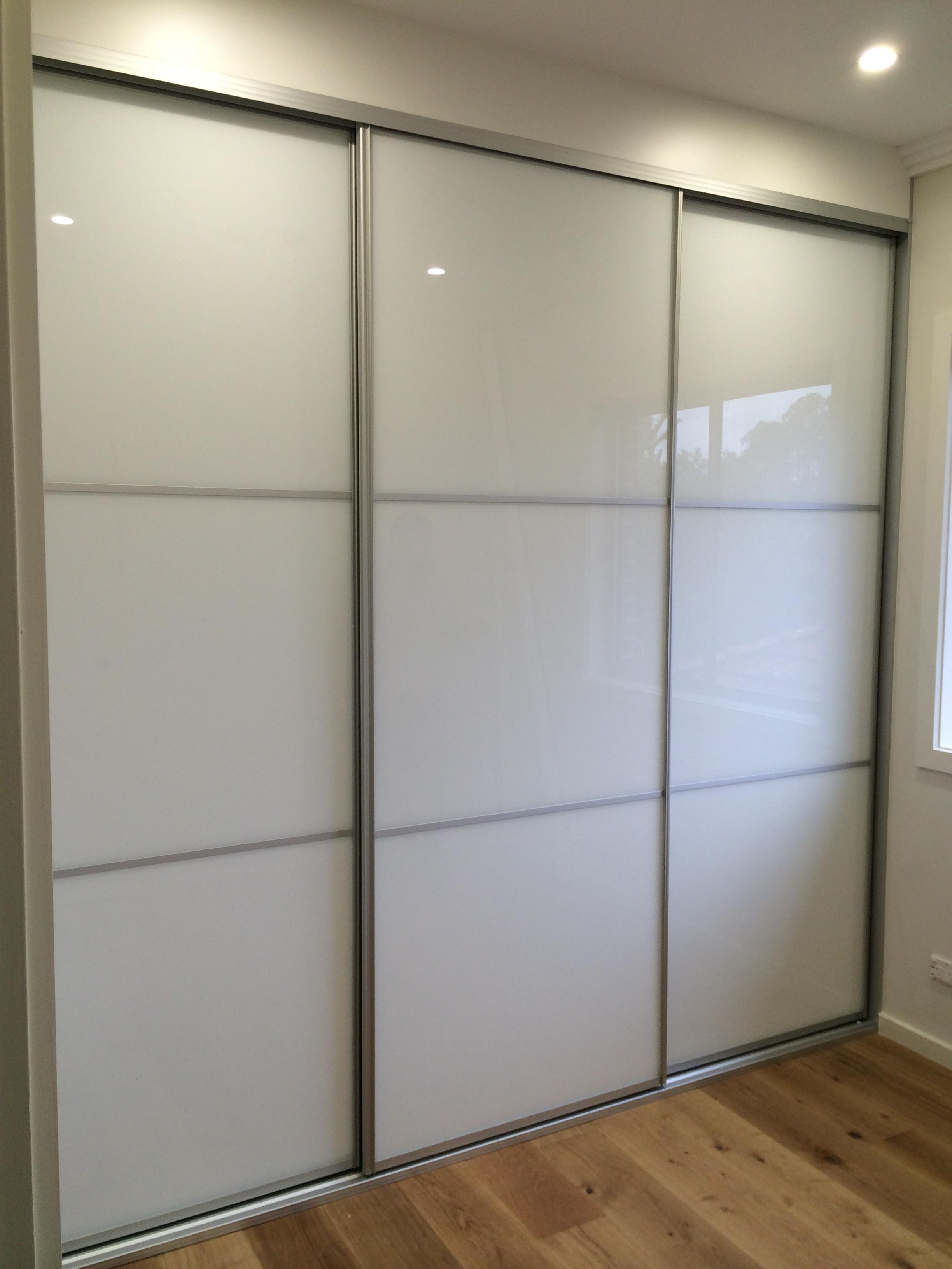 ultrawhite glass sliding doors with matte silver frame.JPG