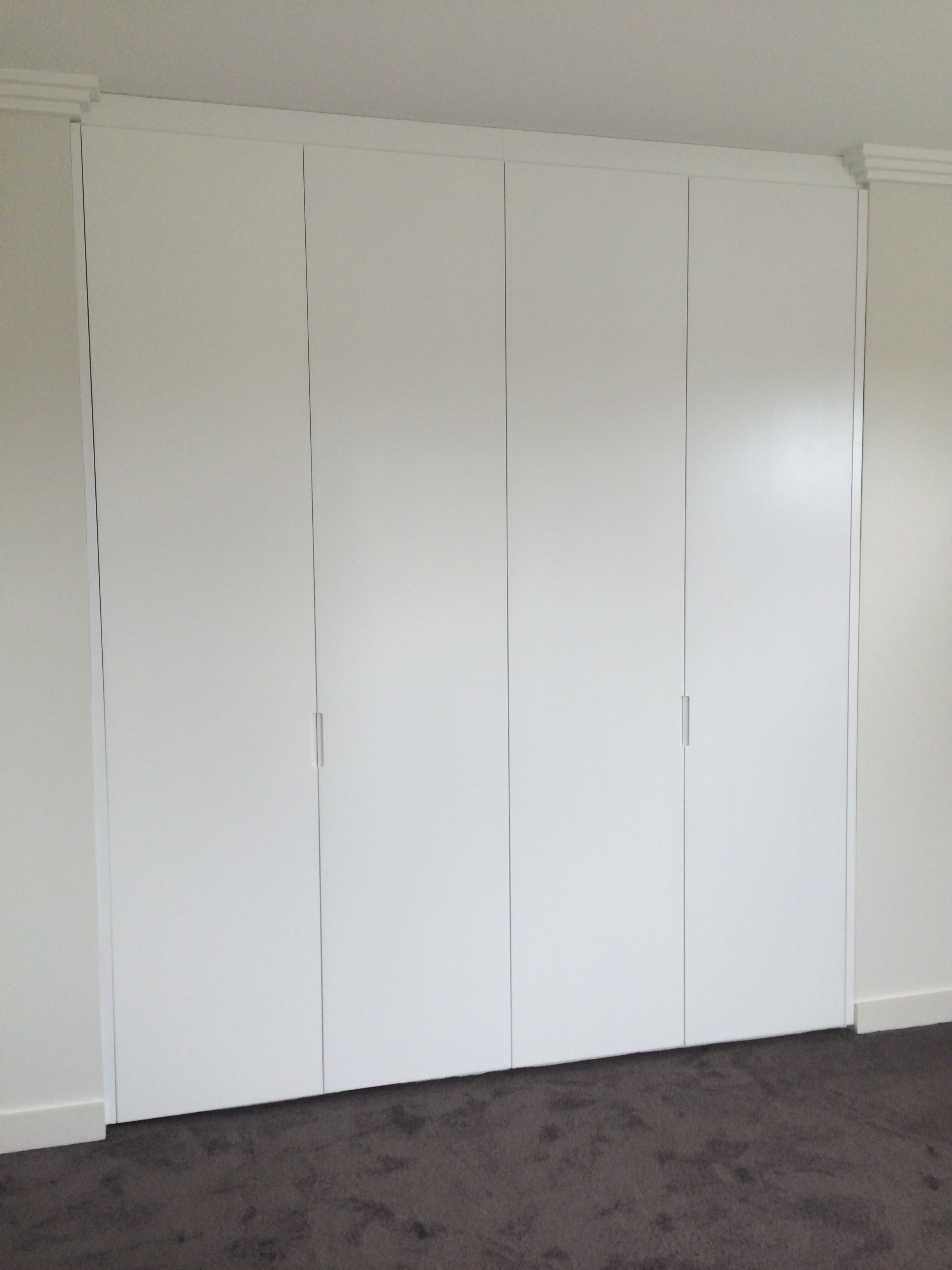 plain polyurethane hinegd doors with 200mm routed side handles.JPG