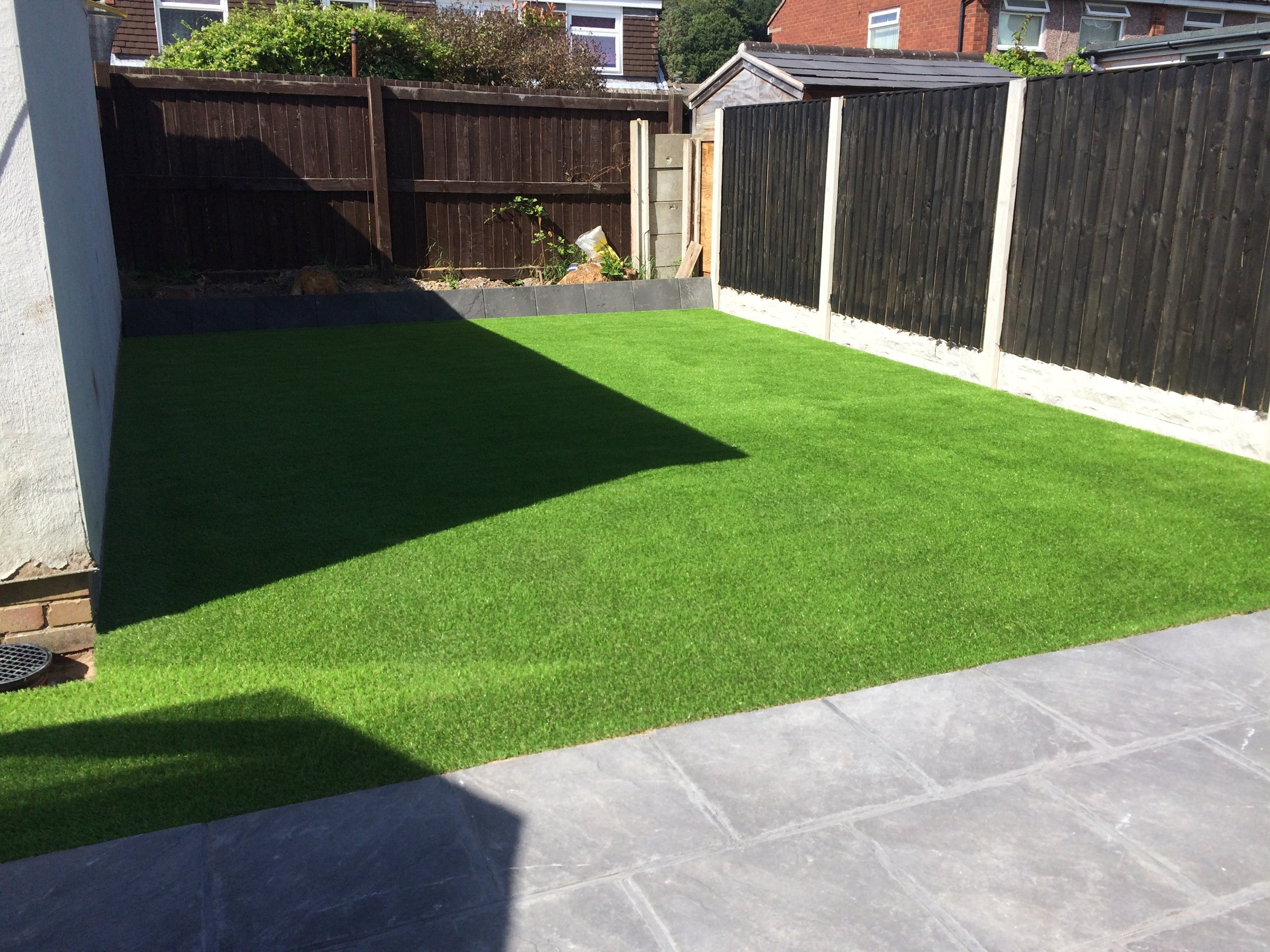 Fake grass and patio paving