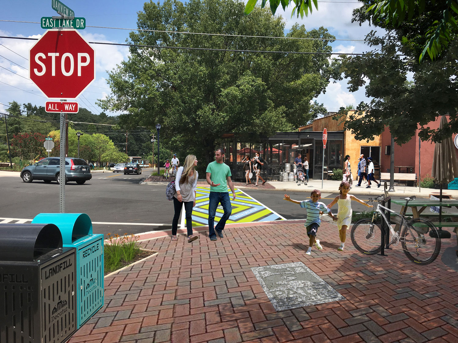 Proposed crossing of East Lake Drive with custom crosswalk and enhanced pedestrian mixing zones with improved pavers.