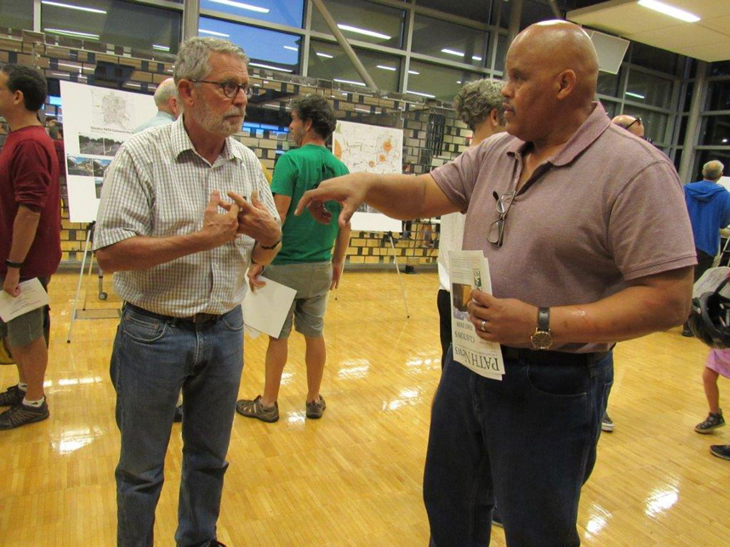 City Manager, Hugh Saxon, Deputy City Manager discusses the trail master plan with an interested citizen