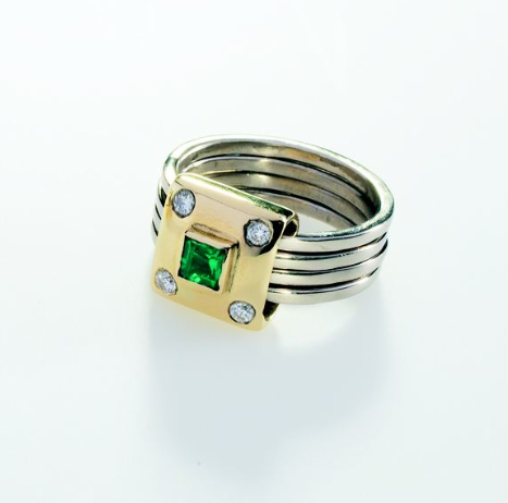 Renaissance ring of a square emerald, with four diamonds