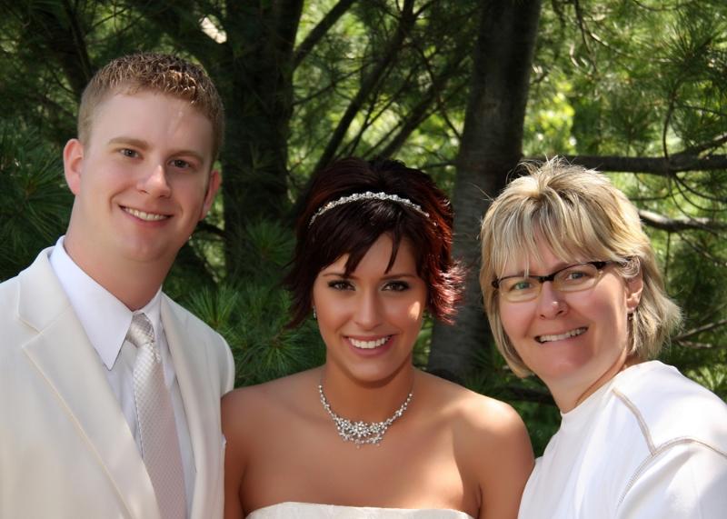 nancy-with.wedding.couple.jpg