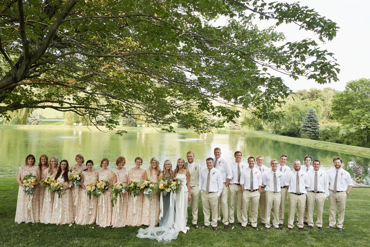 "Normal   0           false   false   false     EN-US   X-NONE   X-NONE                                                                               There were 22 attendants at the wedding. That is a lot of bouquets and boutineers! The pallet was whites, yellow and peaches for the bridesmaids and a more colorful, wildflower bouquet for Rachel. We grew many of the flowers right on the bride's property. The groom and his groomsmen wore simple rosemary and lavender boutineers.                                                                                                                                                                                                                                                                                                    /* Style Definitions */  table.MsoNormalTable 	{mso-style-name:""Table Normal""; 	mso-tstyle-rowband-size:0; 	mso-tstyle-colband-size:0; 	mso-style-noshow:yes; 	mso-style-priority:99; 	mso-style-qformat:yes; 	mso-style-parent:""""; 	mso-padding-alt:0in 5.4pt 0in 5.4pt; 	mso-para-margin-top:0in; 	mso-para-margin-right:0in; 	mso-para-margin-bottom:8.0pt; 	mso-para-margin-left:0in; 	line-height:107%; 	mso-pagination:widow-orphan; 	font-size:11.0pt; 	font-family:""Calibri"",""sans-serif""; 	mso-ascii-font-family:Calibri; 	mso-ascii-theme-font:minor-latin; 	mso-fareast-font-family:""Times New Roman""; 	mso-fareast-theme-font:minor-fareast; 	mso-hansi-font-family:Calibri; 	mso-hansi-theme-font:minor-latin;}"