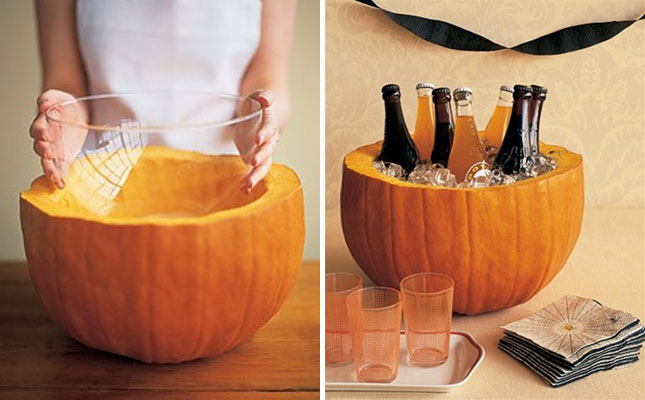 Image via  Martha Stewart   While Jack O' Lanterns are the standard accent piece for this holiday, why not outfit a pumpkin for a  new task ? As an ice bucket or snack bowl, just carve a a pumpkin hollow, grab a clear plastic bowl and fill with ice or treats as desired. Easy enough but also the perfect table addition or centerpiece necessity.