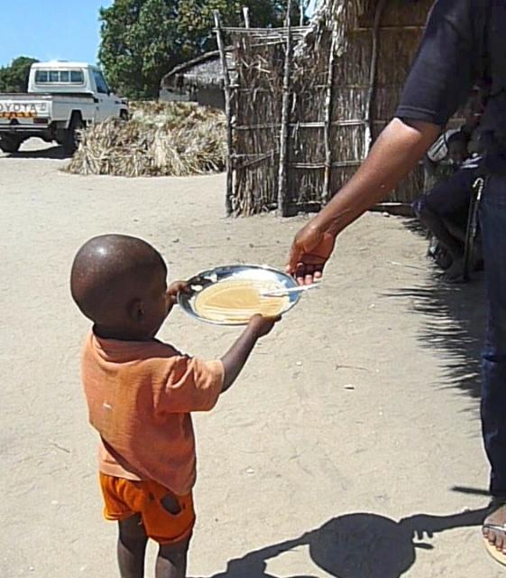 Nursary little boy receiving food (1).jpg
