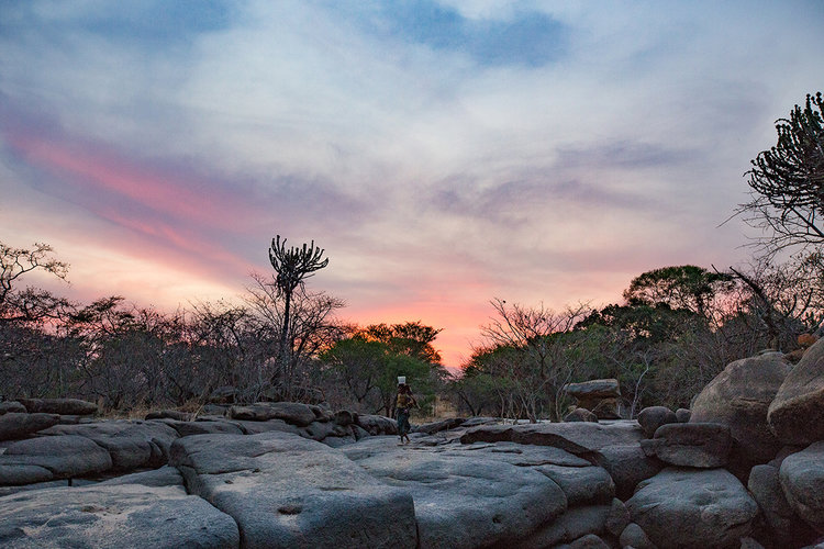 Carrying Water at Sunset by Andrea Griffiths, photographed in Tanzania.