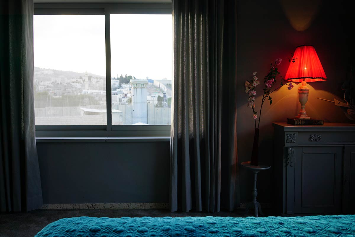Enjoy a room with a view at The Walled Off Hotel.