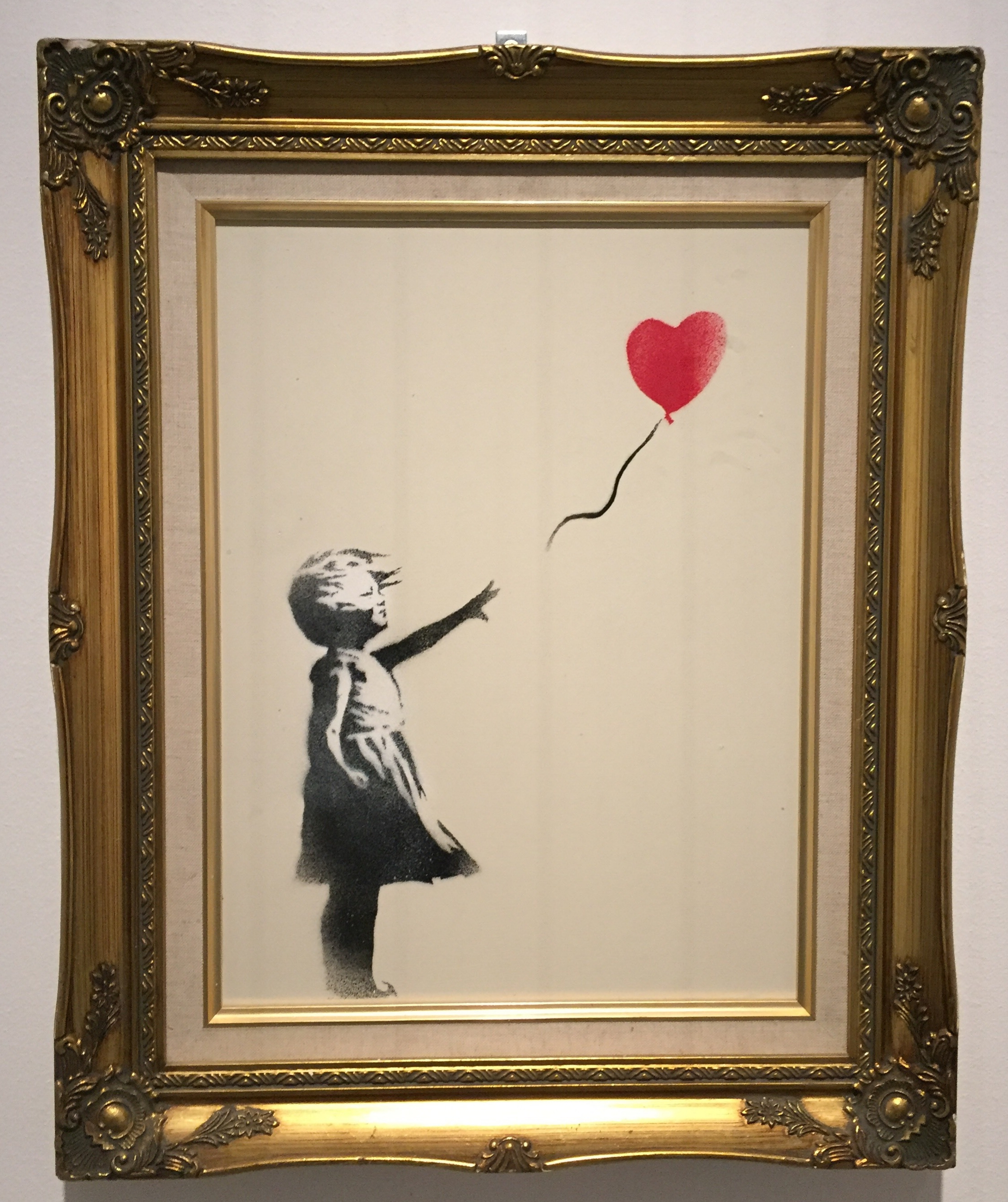 'Girl with Balloon', photo taken by Reem Gallery at the Banksy 'Guerra, Capitalismo & Liberta' exhibition in Rome 2016.