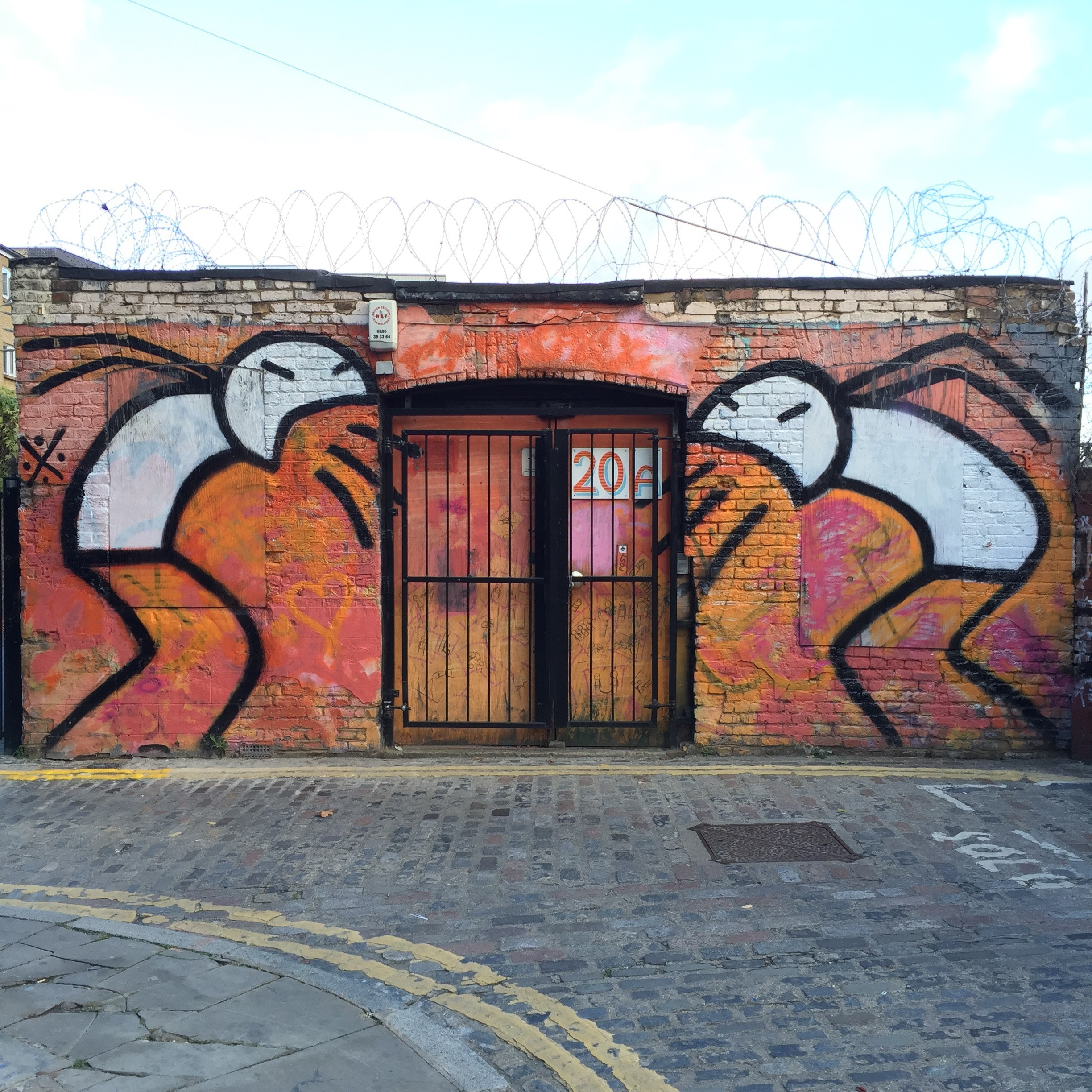 Photographed by Reem Gallery in autumn 2016. Mural is in Grimsby Street, off Brick Lane, London.