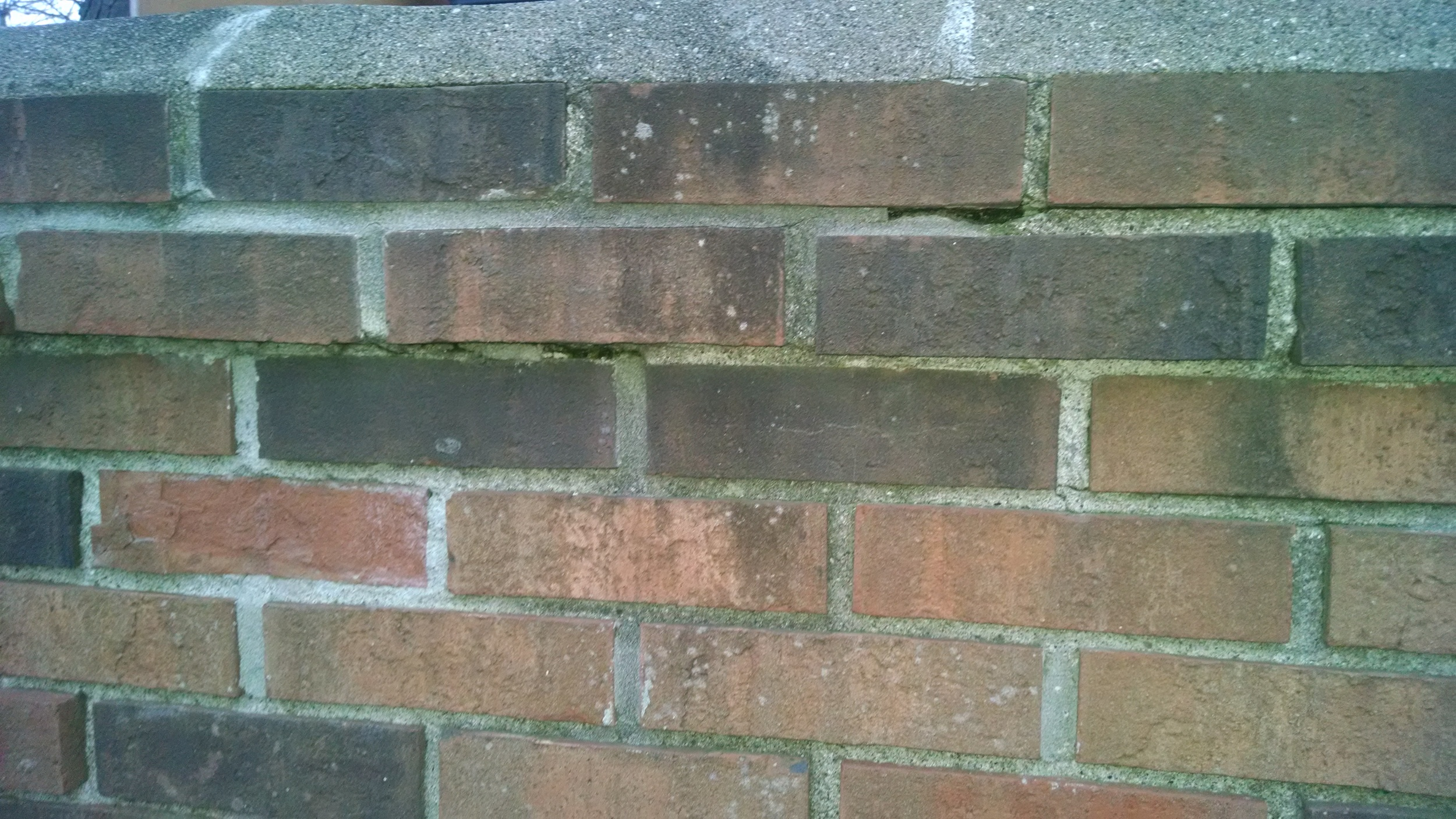 Cracks in mortar between chimney brick
