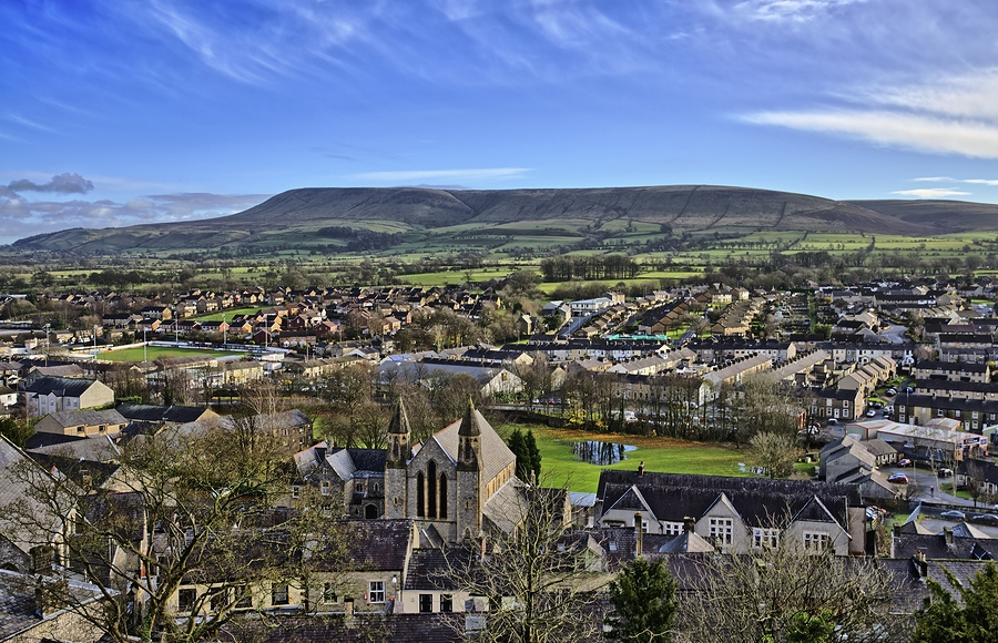 The Saxon town of Clitheroe, and the foreboding and mysterious Pendle Hill behind - the scene of some of the 17th century murders