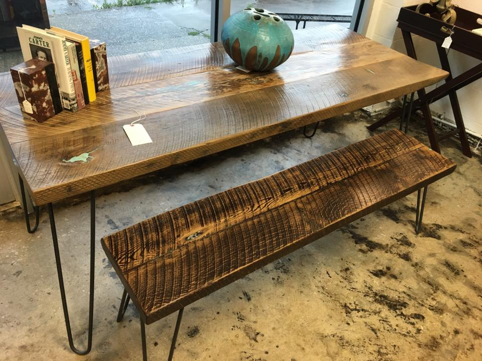 REclaimed floor joists from a bank that had caught fire in Danville, ky. cracks, nail holes, and other distress was filled with crushed turquoise powder and glued in to create a smooth, cleanable surface. hairpin Steel legs were hand crafted by Grant Elrod of Lancaster, PA. Assembly in Winchester, ky