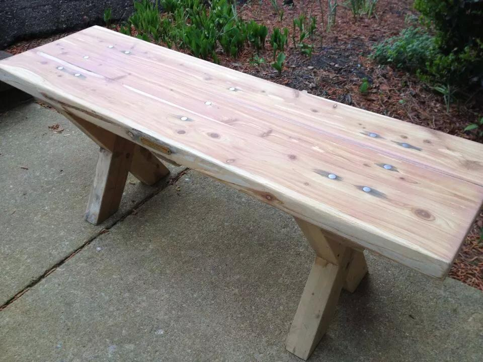 """This piece was hand milled with a chainsaw from a fallen cedar tree in oxford, nc. the legs are notched and the entire piece has no screws or nails. It is held together by (21) 1/2"""" steel pegs. After being assembled in Raleigh, NC, the piece sat outside for a full year to achieve the staining around the pegs. then sanded and finished with a matte sealer."""