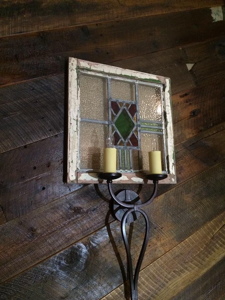 Craftsman Reclaimed crafted this barn wood wall was set over reclaimed burlap coffee and coco bean bags. Lights were placed in front of an inlaid recycled stained glass window. constructed in belle meade, tn.
