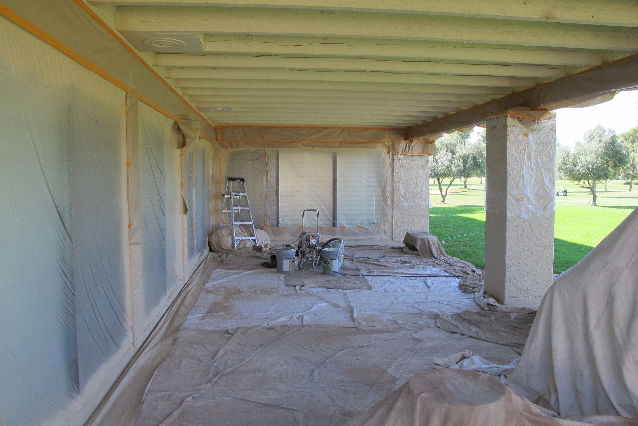 Surfaces are carefully masked to prevent overspray