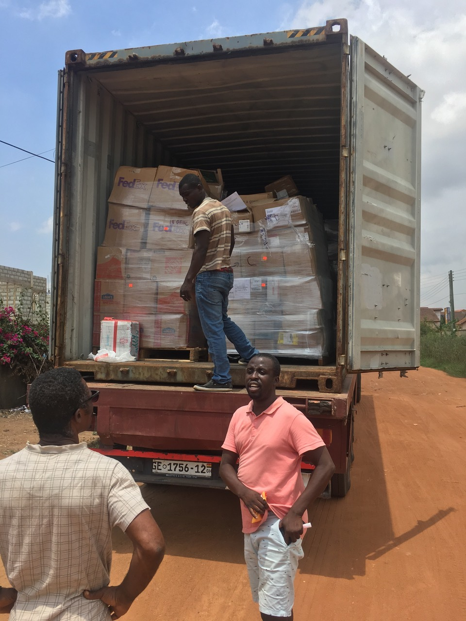 unloading books for the library project in Ghana