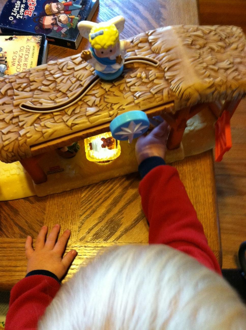 Ry playin with nativity.jpg