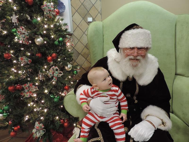 Issie on Santas lap at cfa 2013.JPG
