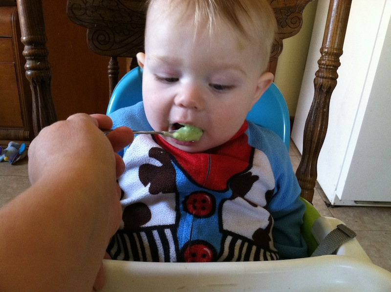 Issie eating homemade spinach and apples babyfood.JPG