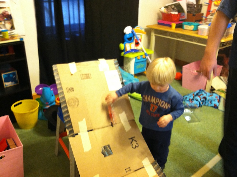 2 car ramp Indoor Activities to keep a toddler happy and busy.jpg