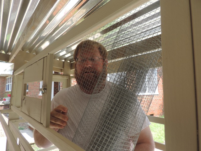 finishing touches to quail coop.JPG
