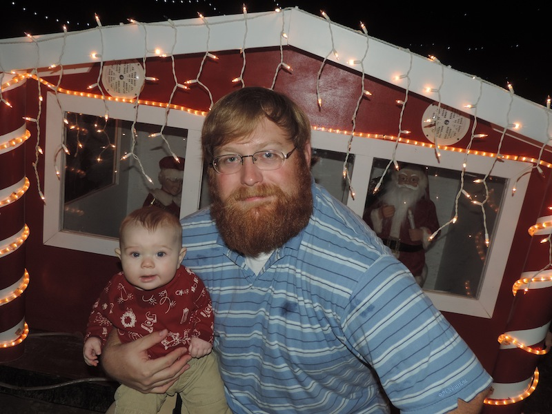 isaac and jason in front of Christmas lights.JPG