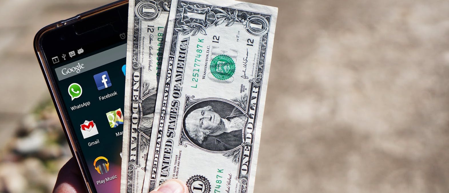 mobile-phone-money-banknotes-us-dollars-163069.jpg